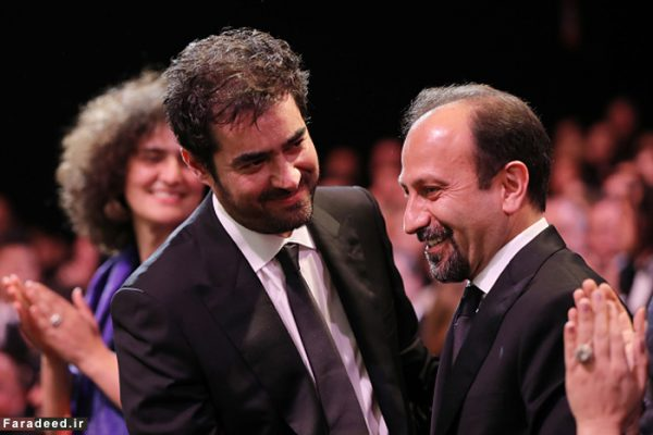 Iranian actor Shahab Hosseini (C) celebrates with Iranian director Asghar Farhadi after being awarded with the Best Actor prize during the closing ceremony of the 69th Cannes Film Festival in Cannes, southern France, on May 22, 2016. / AFP / Valery HACHE (Photo credit should read VALERY HACHE/AFP/Getty Images)